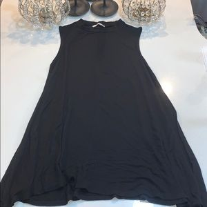 Never worn soft sleeveless black mini dress